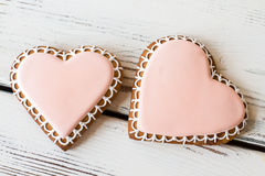 Two heart-shaped cookies. Stock Images