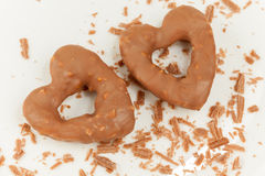 Two heart-shaped cookies with glaze of chocolate Royalty Free Stock Photos