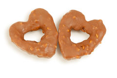 Two heart-shaped cookies with glaze of chocolate Stock Image