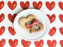 Two heart-shaped cookies tied together Royalty Free Stock Image