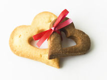 Two heart-shaped cookies tied together Royalty Free Stock Photo