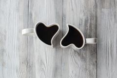 Two Heart Shaped cups with coffee Royalty Free Stock Photography