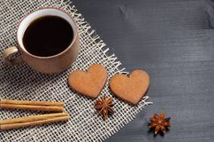 Two heart shaped ginger cookies, coffee and spice royalty free stock images