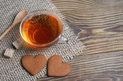 Two heart shaped ginger cookies and tea royalty free stock images