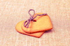 Two heart shaped gingerbread cookies Royalty Free Stock Photos