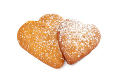 Two heart shaped gingerbread cookies with powdered sugar on white Stock Photo