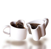 Two heart shaped love cups of coffee levitating. On white background Stock Photography