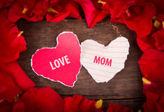 Two Heart shaped paper  on wood with decoration of red rose Stock Photography