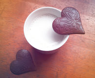 Two Heart-shaped pieces of chocolate Stock Photography