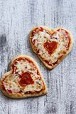 Two Heart Shaped Pizza for Valentine's Day Stock Photos