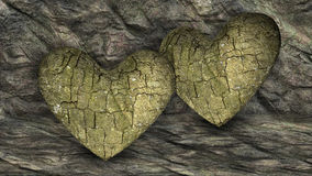 Two Heart Shaped Rocks over a background with Rocks Stock Images