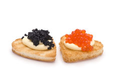 Two Heart-Shaped Toasts with Caviar Royalty Free Stock Photo