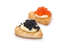Two Heart-Shaped Toasts with Caviar Stock Image