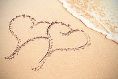 Two heart shapes inscribe on sand Royalty Free Stock Photography