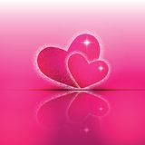 Two heart shapes with theirs reflection on colorful background to the Valentine's day. Royalty Free Stock Photo