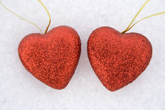 Two heart on snow Stock Photos