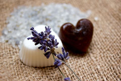 Two Heart Soaps, Lavender Twigs and Bath Salt on Jute Underlay. Useful as background. Natural shades of colors Royalty Free Stock Photography