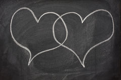 Two heart speech bubbles on blackboard Royalty Free Stock Image