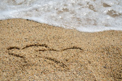 Two Heart Symbols in Sand Stock Image