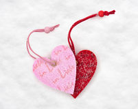 Two heart toys in snow Stock Photos