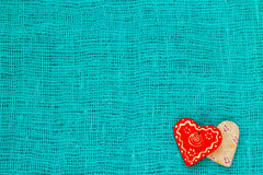 Two heart on a turquoise background St. Valentine`s Day Stock Photography
