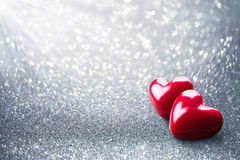 Two Hearth On Silver Glitter Stock Photo