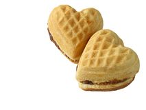 Two hearts. Two heart like biscuits over white backgroud Stock Images