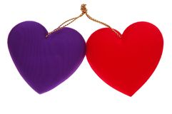 Two Hearts. Two red & purple fabric hearts tied together with gold rope -  isolated on white Royalty Free Stock Photography