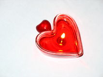Two hearts. Two burning heart. Burning candle in the form of the heart Royalty Free Stock Photo