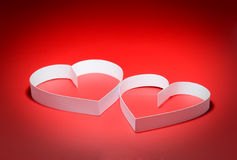 Two hearts. St. Valentine Day. Two hearts,on red background Royalty Free Stock Photo