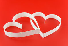 Two hearts. St. Valentine Day. Two hearts,on white background Royalty Free Stock Photography