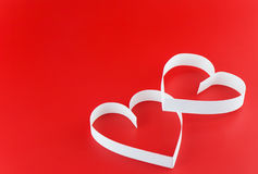 Two hearts. St. Valentine Day. Two hearts,on red background Royalty Free Stock Images