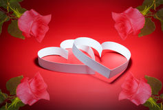 Two hearts. St. Valentine Day. Two hearts,on red background Stock Photos