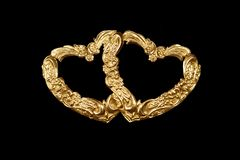 Two hearts. Antique repousse entwined hearts as frames or design element Stock Photography