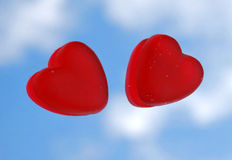 Two hearts. Two red hearts with a blue sky Stock Photography