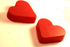 Two Hearts. Two red plastic valentines hearts Stock Images