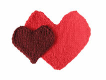 Two hearts. Two knitted hearts on the white background Stock Images