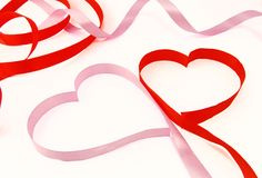 Two hearts. From red and pink ribbon stock images