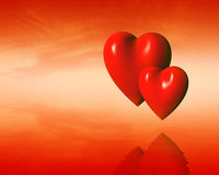 Two hearts. Abstraction with heart on a sky with sea background Royalty Free Stock Photo