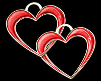 Two hearts. Two red shining harts gold-mounted on black background, pendant Royalty Free Stock Photo