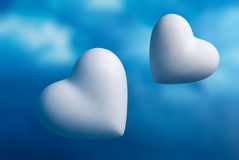 Two hearts against a blue sky Royalty Free Stock Images