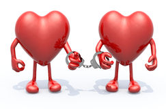 Two hearts with arms and legs linked by handcuffs on hands Stock Photography
