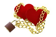 Two hearts associated chain on the castle. Valentine`s Day Isolated. Two hearts out of velvet paper associated chain on the castle. Valentine`s Day. Symbol of Royalty Free Stock Image