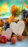 Two hearts in an autumn background Royalty Free Stock Photo