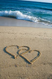 Two Hearts on the Beach. Two Hearts painting into the Sand Royalty Free Stock Photography