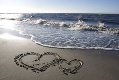 Two hearts on the beach. Two hearts drawn on the beach stock photos