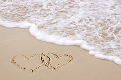Two hearts on the beach. Stock Image