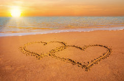 Two hearts on beach sand Royalty Free Stock Photo