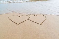 Two hearts on the beach Stock Photos