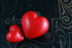 Two Hearts on Black Vintage Background Royalty Free Stock Photography